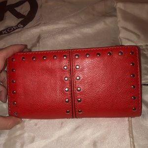 Red/coral Michael Kors wallet with silver studs